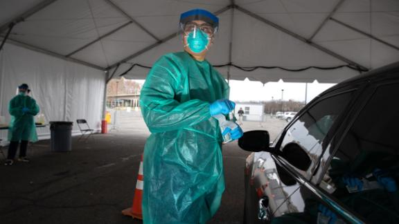 NEW YORK, NY  - MARCH 28: A doctor from SOMOS Community Care prepares to test a patient at a drive-thru testing center for COVID-19 at Lehman College on March 28, 2020 in the Bronx, New York City. The center, opened March 23 at Lehman College, can test up to 500 people per day for coronavirus. (Photo by John Moore/Getty Images)