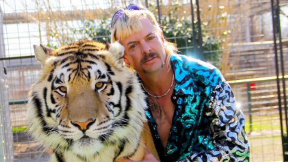 "Joseph Maldonado-Passage aka Joe Exotic and one of his cats in the Netflix docuseries ""Tiger King: Murder, Mayhem and Madness."""