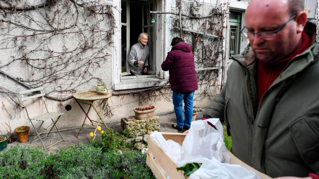 Farmers deliver vegetables to a customer in Saint-Georges-sur-Cher, France, on March 29, 2020.