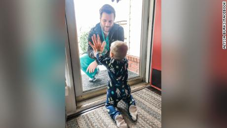 The doctor in the viral photo with his son behind glass has lost his home to a tornado