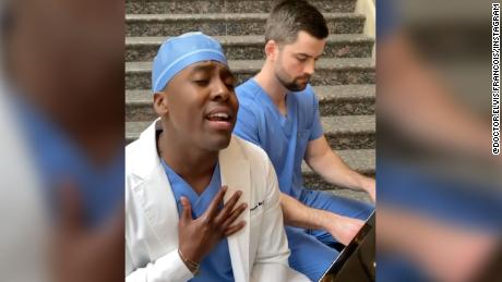 "Dr. Elvis L. Francois and Dr. William Robinson perform a cover of John Lennon's ""Imagine."""