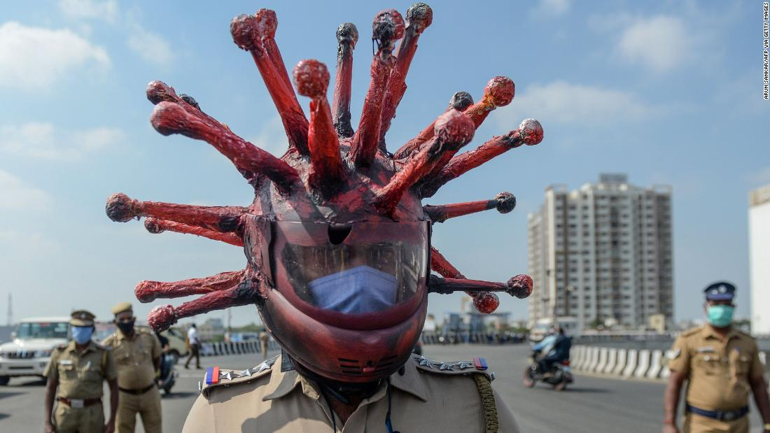 India lockdown: Police officer wears a coronavirus helmet to warn people to stay inside