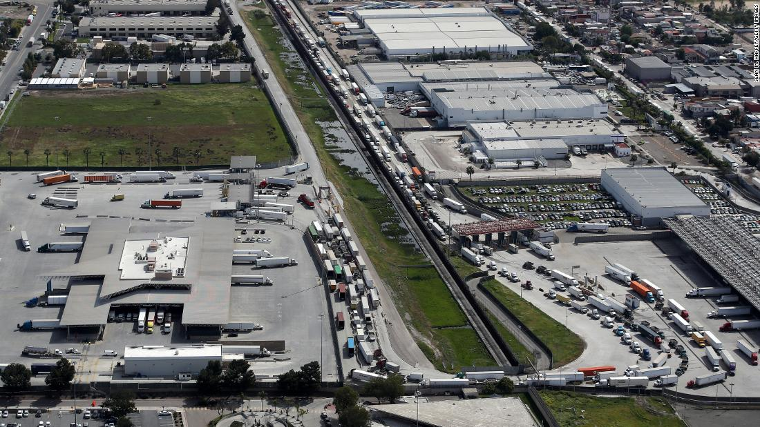 Commercial freight trucks line up to cross into the United States from Mexico through the U.S. Customs and Border Protection - Otay Mesa Port of Entry in San Diego, California.