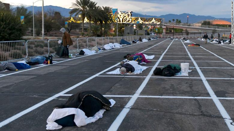 People rest at a temporary homeless shelter at Cashman Center in Las Vegas on Sunday, March 29.
