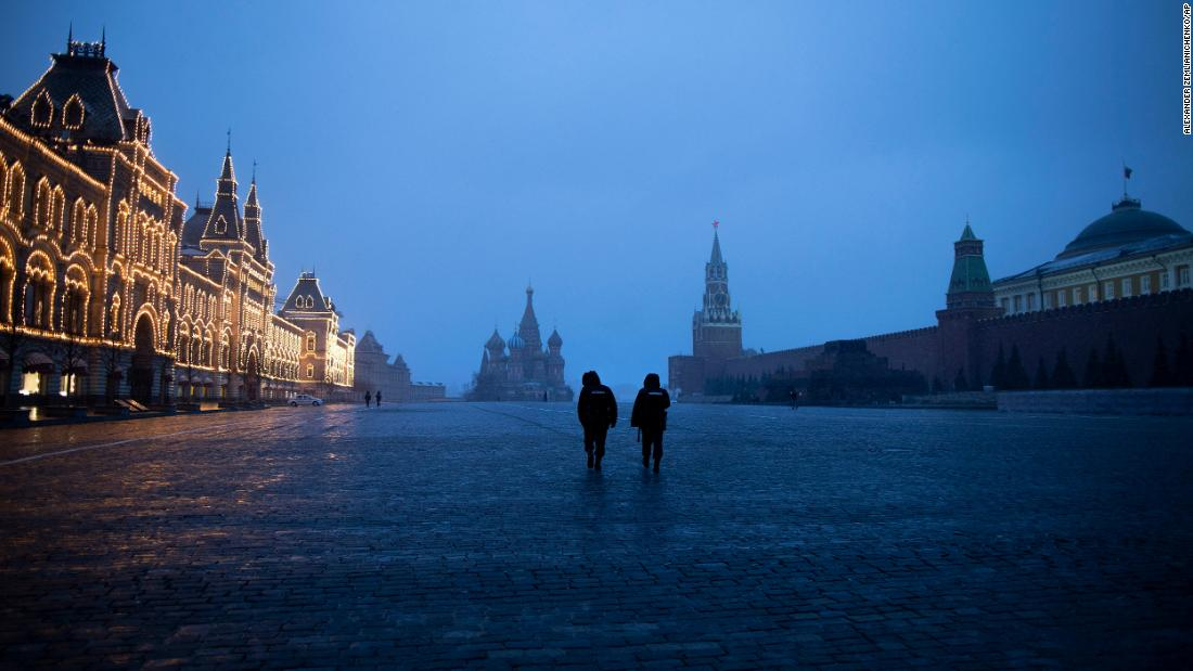 Two police officers in Moscow patrol an almost empty Red Square on March 30.
