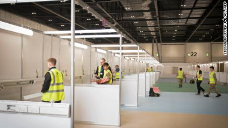 Members of the military and private contractors, seen Monday, help to prepare the ExCel centre in London to become a field hospital to be known as the NHS Nightingale Hospital.
