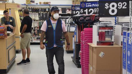 Walmart will start taking employees' temperatures and let them wear masks
