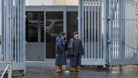Swiss Guards stand at an entrance gate to the Vatican during Italy's lockdown.