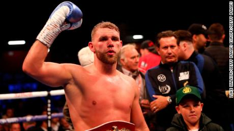 Billy Joe Saunders celebrates his win over Shefat Isufi to win the vacant WBO super-middleweight title.