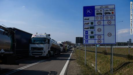 Trucks wait to be processed  at the Polish-Ukrainian border Korczowa on March 28, 2020 in Korczowa, Poland. Ukrainian President Volodymyr Zelensky announced to close all Polish-Ukrainian borders for non-Ukranian citizens by end of March 27, 2020 to stop the spread of COVID-19. (Photo by Omar Marques/Getty Images)