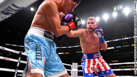 Saunders punches Marceleo Coceres during their WBO world super-middleweight fight at Staples Center in 2019.