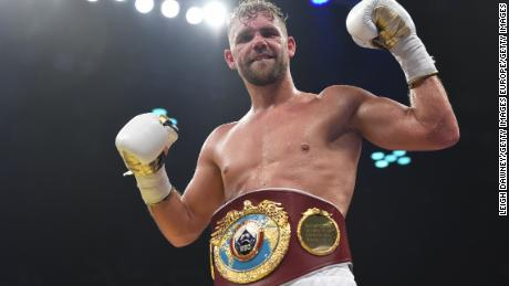 Saunders celebrates defeating Willie Munroe Jr. for the WBO world middleweight title.