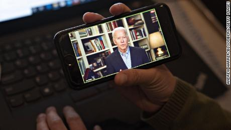 Former Vice President Joe Biden, 2020 Democratic presidential candidate, speaks during a virtual press briefing on a smartphone in this arranged photograph in Arlington, Virginia, Wednesday, March 25, 2020.