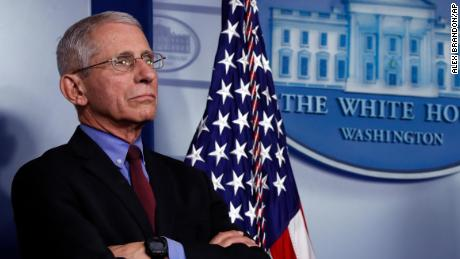 Dr. Anthony Fauci, director of the National Institute of Allergy and Infectious Diseases, listens during a briefing about the coronavirus in the James Brady Press Briefing Room, Friday, March 27, 2020, in Washington.