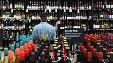 "A patron stands in front of a shelf full of wine bottles at The Liquor Store.Com on March 20, 2020 in the Brooklyn borough of New York. - Liquor sales have exploded in New York since a national emergency was declared and New York closed all its theatres, bars and restaurants, while virtual cocktail parties with ""quarantinis"" are on the rise. (Photo by Angela Weiss / AFP) (Photo by ANGELA WEISS/AFP via Getty Images)"