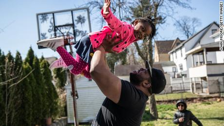 More dads are home with their children than ever before, as a result of job losses and business closures during the coronavirus pandemic. (John Moore/Getty Images)
