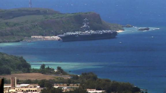 USS Theodore Roosevelt aircraft carrier sits on the outskirts of Apra Harbor, Guam, on April 1. At least 70 sailors have tested positive for coronavirus aboard the aircraft carrier.