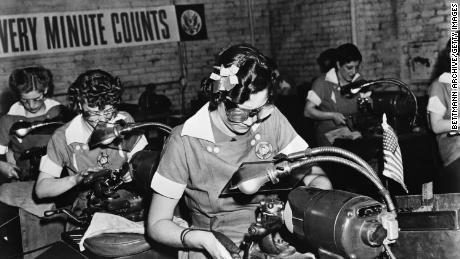 During World War II, millions of women entered the workforce for the first time. Likewise, the coronavirus pandemic is forcing millions of dads to be primary childcare providers for the first time in their working lives, economists say. (Bettmann Archive/Getty images)