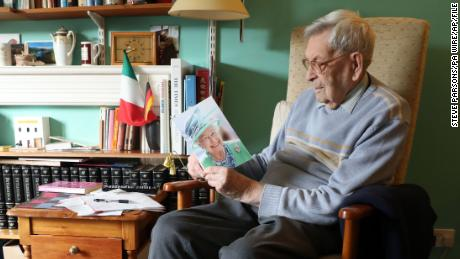 The oldest living man is British pensioner Robert Weighton, who is 112 years old, seen holding a telegram from the Queen in February 2018.