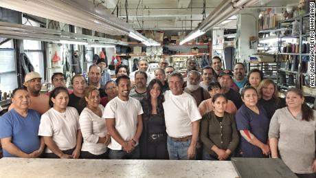 The employees of Pietro Handbags pose for a photo in their factory in New York City.