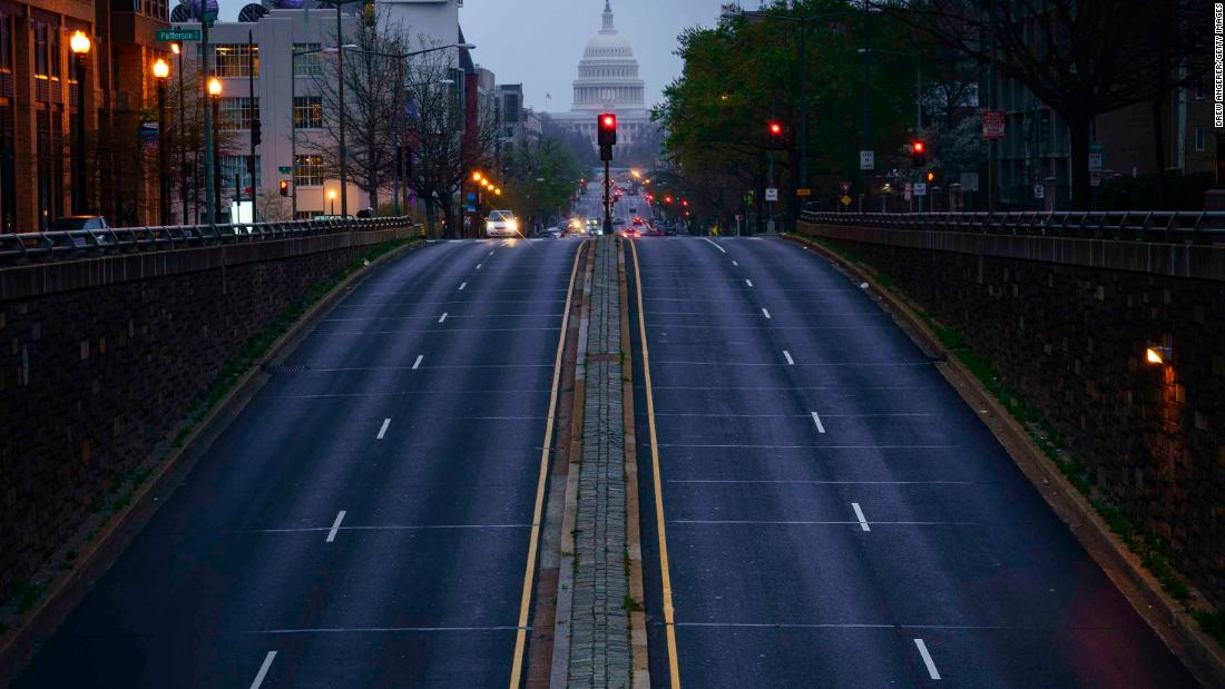 In Washington, a mostly empty North Capitol Street is seen at dusk on March 31.