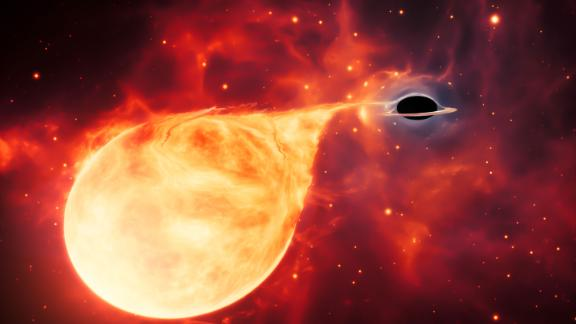 This artist's illustration shows an intermediate-mass black hole tearing into a star.