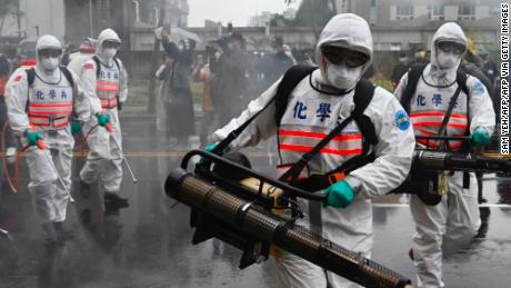 Soldiers from the militarys chemical units take part in a drill organised by the New Taipei City government to prevent the spread of the COVID-19 coronavirus, in Xindian district on March 14, 2020. - Over 450 medical staff, community volunteers, government employees and military personnel took part in the drill. Despite being so close to the original outbreak in mainland China, Taiwan has just 48 confirmed cases of the Covid-19 disease with one death. (Photo by Sam Yeh / AFP) (Photo by SAM YEH/AFP via Getty Images)
