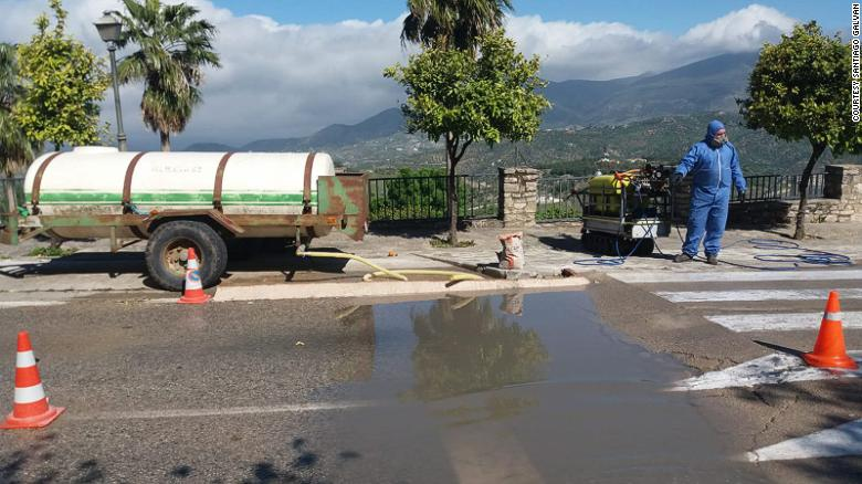 Four of the town's entrances were blocked, leaving just one, which has a manned checkpoint where vehicles are sprayed with a mix of bleach and water.