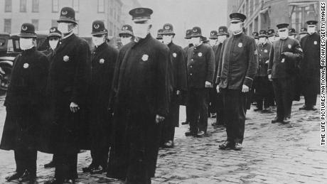 In the 1918 flu pandemic, some violators of mask laws were fined or imprisoned