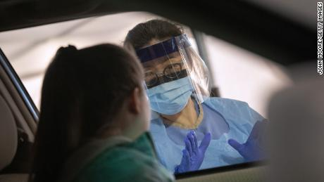 SEATTLE, WASHINGTON - MARCH 13: A nurse prepares to swab a person's nose while testing for coronavirus at the University of Washington Medical center on March 13, 2020 in Seattle, Washington. UW Medical staff feeling COVID-19 type symptoms were asked to pass through a drive-through screening center on campus for testing.  (Photo by John Moore/Getty Images)