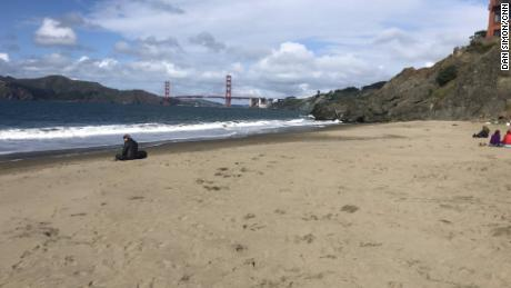 A near empty China Beach in view of the Golden Gate Bridge indicates that San Franciscans are abiding by the stay-at-home mandate.
