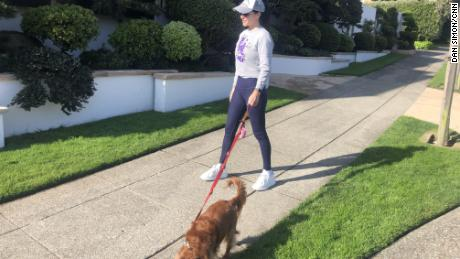 Simon's wife Katherine makes sure to stay more than 6 feet away from anyone she sees out while walking the family dog, Coco.