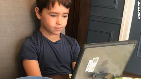 Second grader Jack Simon takes a class through Zoom, powered by Nutella on toast.