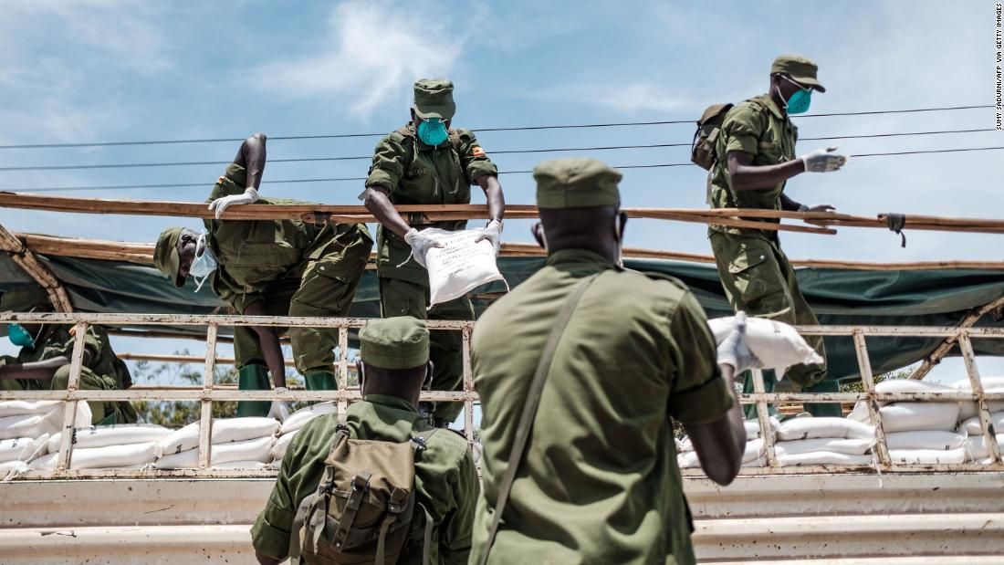 Paramilitary members unload provisions in Kampala, Uganda, on Saturday, April 4. It was the first day of government food distribution for people affected by the nation's lockdown.