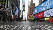 View of an almost empty Time Square on April 03, 2020 in New York. - In New York, the epicenter of the US outbreak, Mayor Bill de Blasio urged residents to cover their faces when outside and Vice President Mike Pence said there would be a recommendation on the use of masks by the general public in the next few days. (Photo by Angela Weiss / AFP) (Photo by ANGELA WEISS/AFP via Getty Images)