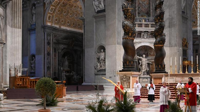 Pope Francis celebrates Palm Sunday mass behind closed doors at the Chair of Saint Peter in St. Peter's Basilica.