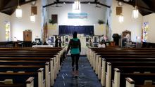 Churches hold Palm Sunday services despite state bans on gatherings