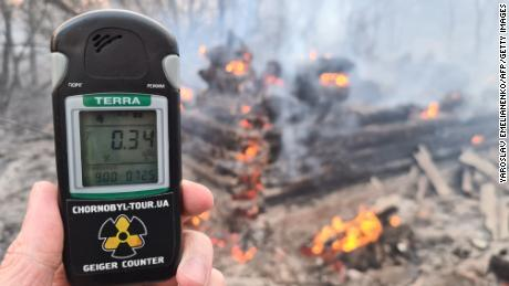 A Geiger counter near the site of the fire on Sunday shows a radiation level slightly below the maximum permissable amount. Other footage taken near the fire shows higher readings.