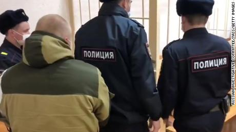 A man was detained in connection with a mass shooting in an apartment building in the village of Yelatma, seen here (left) during a hearing at Kasimovsky District Court.