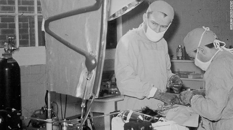 Dr. Francis Robicsek with the heart-lung machine he helped build to perform open-heart surgeries.