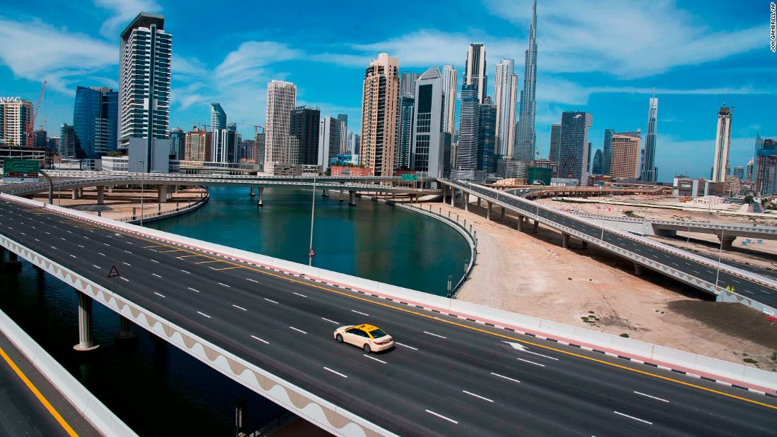 A lone taxi drives over a typically gridlocked highway in Dubai, United Arab Emirates, on April 6.