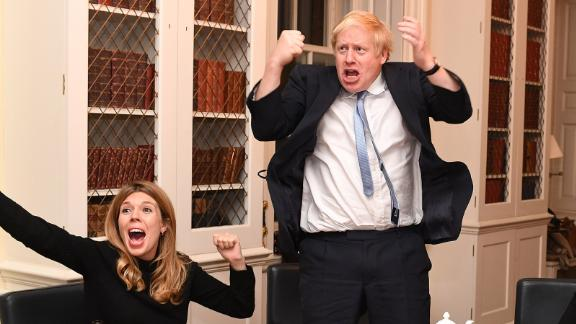Johnson and his partner, Carrie Symonds, react to election results from his study at No. 10 Downing Street.