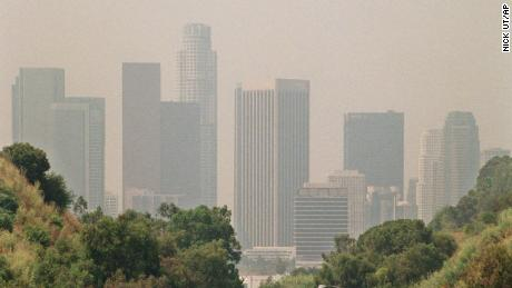 HOLD FOR STORY - FILE - In this July 1998 file photo, traffic drives toward downtown Los Angeles on the 110 freeway as a curtain of smog shrouds the skyline. Southern California is having its smoggiest summer in nearly a decade and hospitals report an increase of people with breathing problems. The South Coast Air Quality Management District says ozone levels exceeded federal standards for all but four days in June 2016. July had only one clean-air day, and there hasn't been a single day so far in August. The worst-hit areas are in the mountains and inland areas outside of Los Angeles. (AP Photo/Nick Ut, File)