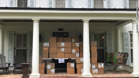 Masks that volunteers were able to repair are packed up on Stephanie Lepone's porch.
