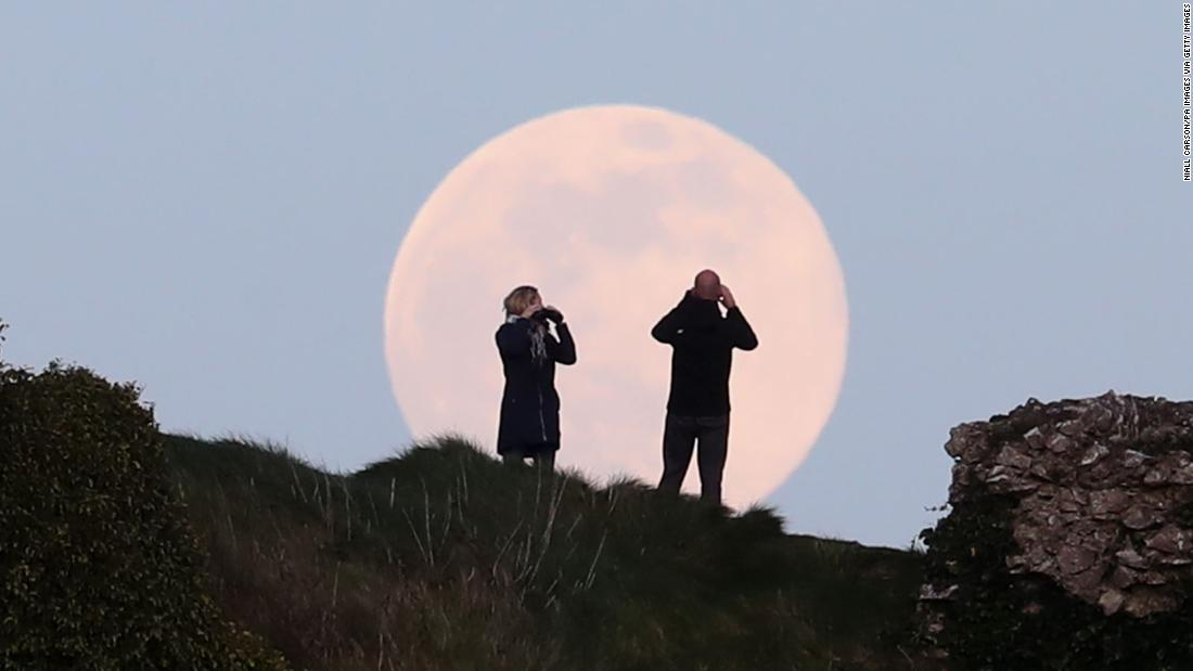 The pink supermoon rises over the Rock of Dunamase in Laois, Ireland.