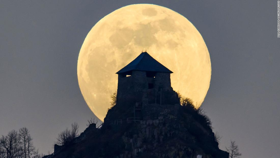 The full moon rises above Salgo castle in Hungary.