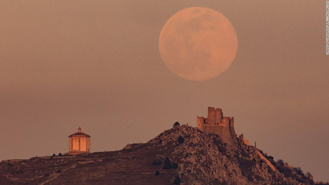 The supermoon rises behind Rocca Calascio castle in Italy.