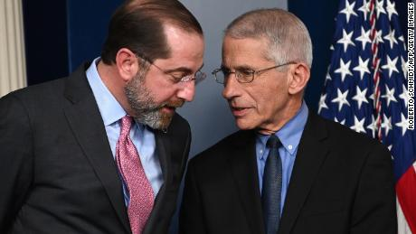 Health and Human Services Secretary Alex Azar (L) and Director of the National Institute of Allergy and Infectious Diseases at the National Institutes of Health Anthony Fauci speak before President Donald Trump arrives for a press conference on the coronavirus.