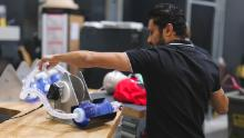 Engineer Vishal Doshi runs tests on an early prototype of a bridge ventilator in Virgin Orbit's Long Beach, California lab.