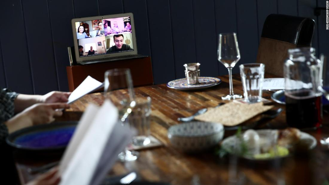 Californians Sarah and Aaron Sanders, along with their children, use video conferencing to celebrate a Passover Seder with other family members.